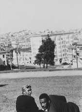 Robert Frank, man and woman sitting in park above san francisco skyline