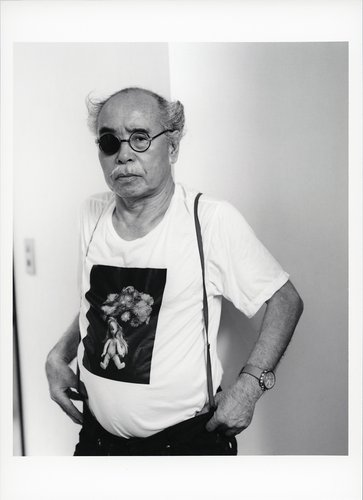 Black and white portrait of an Asian man wearing an eye patch, Araki