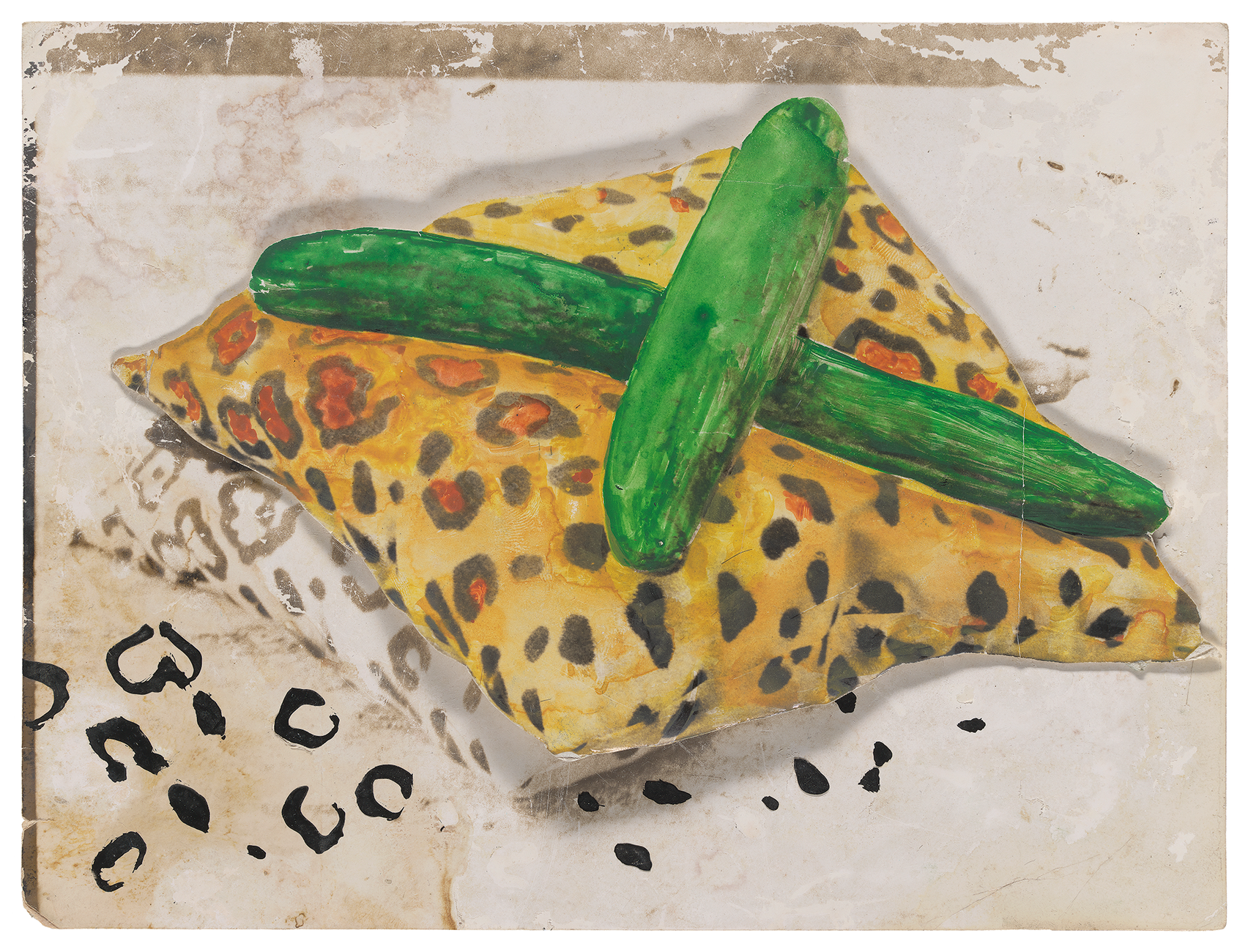 yellow leopard patterned pillow with two cucumbers crossed on top