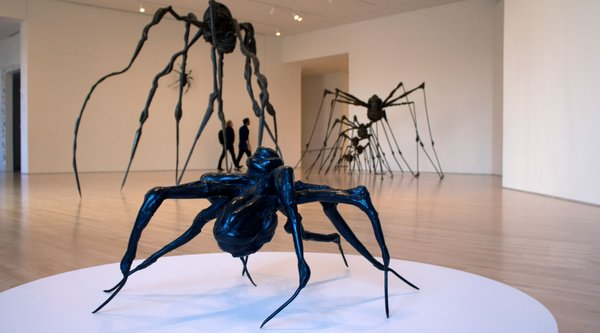 black spider sculptures in a gallery, Bourgeois Spiders