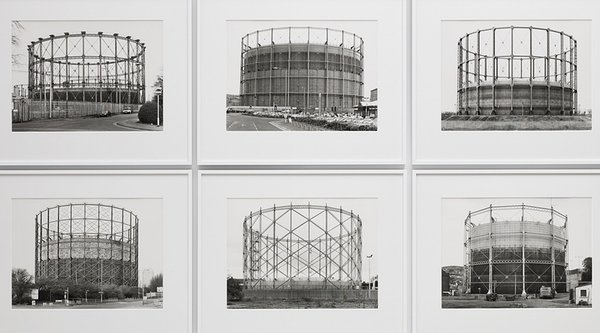 A grid of black and white photographs depicting industrial buildings