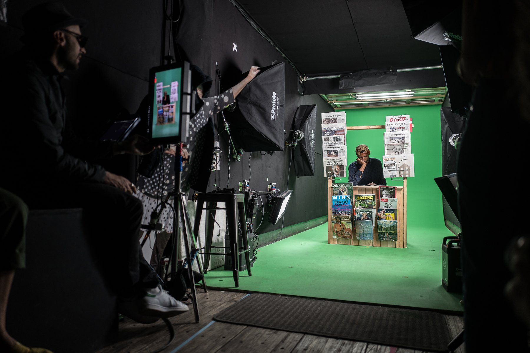 a propped up newstand in a green screen studio