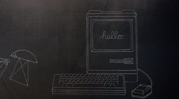 "A chalkboard drawing of a vintage Mac computer with the word ""hello."" written on the screen."
