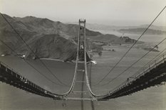 A black and white image looking down from the top of the Golden Gate Bridge