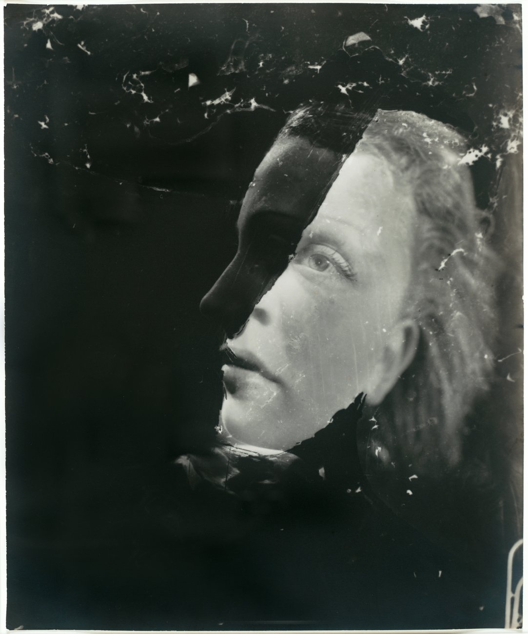 A double photograph of a blue-eyed woman seen straighton and in profile against an uneven black background