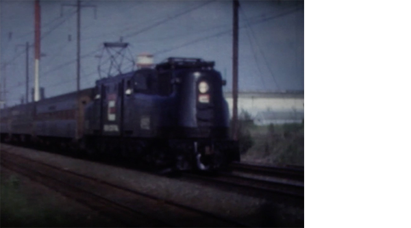 Film still of an approaching train