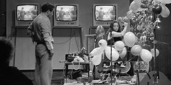 Black and white photo of Nam June Paik and Charlotte Moorman
