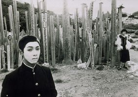 Terayama, black and white still of boy and girl in costume