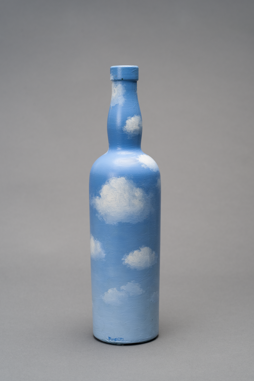 A wine bottle painted light a blue sky filled with fluffy white clouds