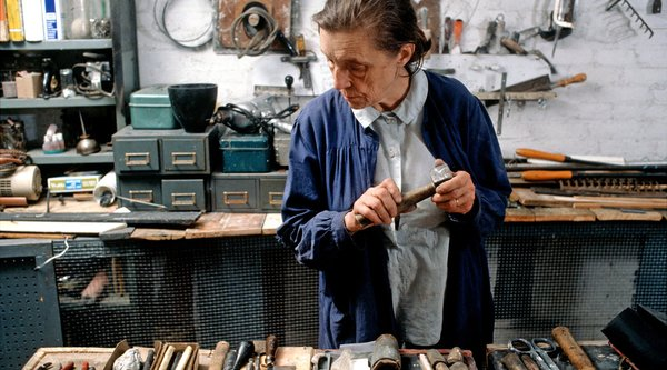 Artist Louise Bourgeois in the studio