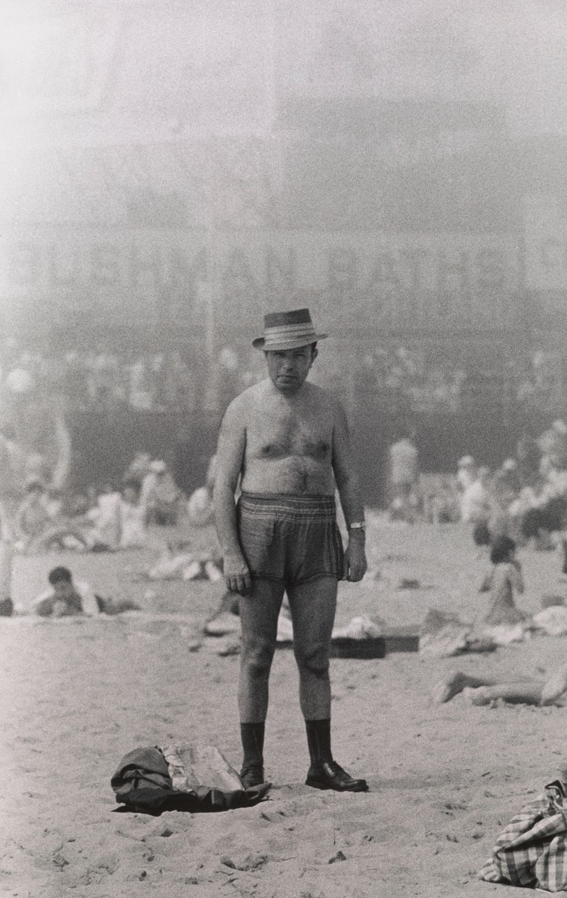 Artwork image, Diane Arbus, Man in hat, trunks, socks and shoes