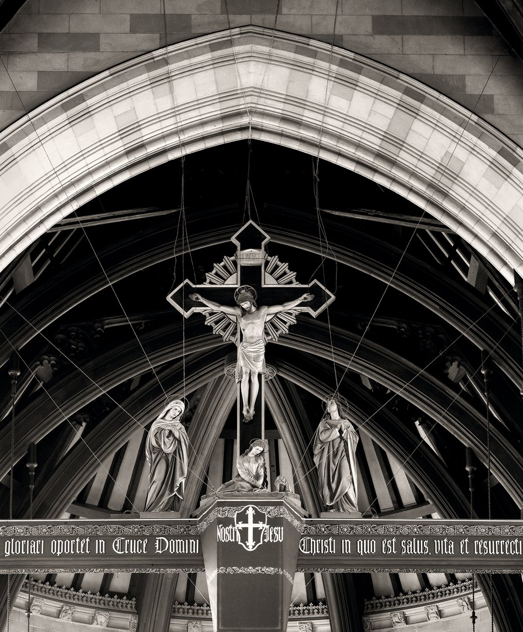black and white photograph of a cross in a Church