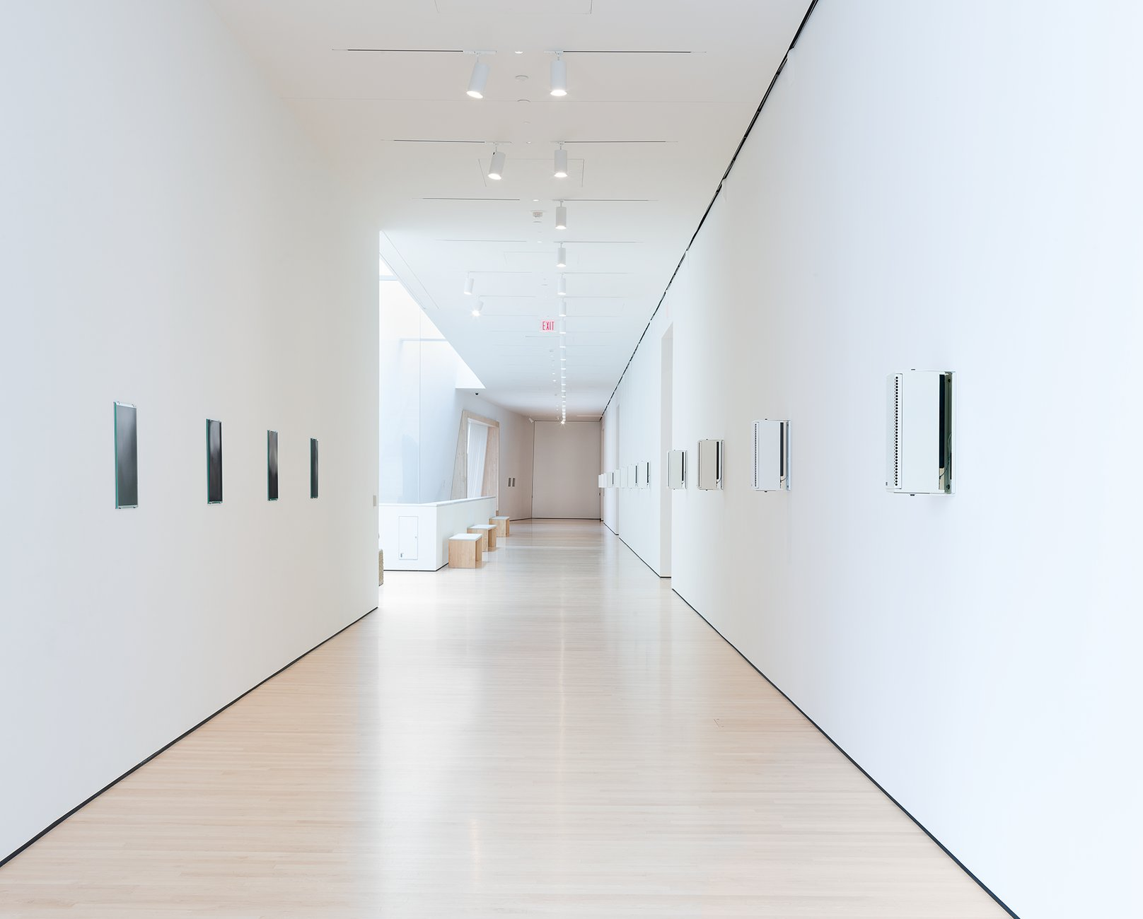 A white gallery hallway with speakers mounted on the wall, Philipsz, Soundtracks