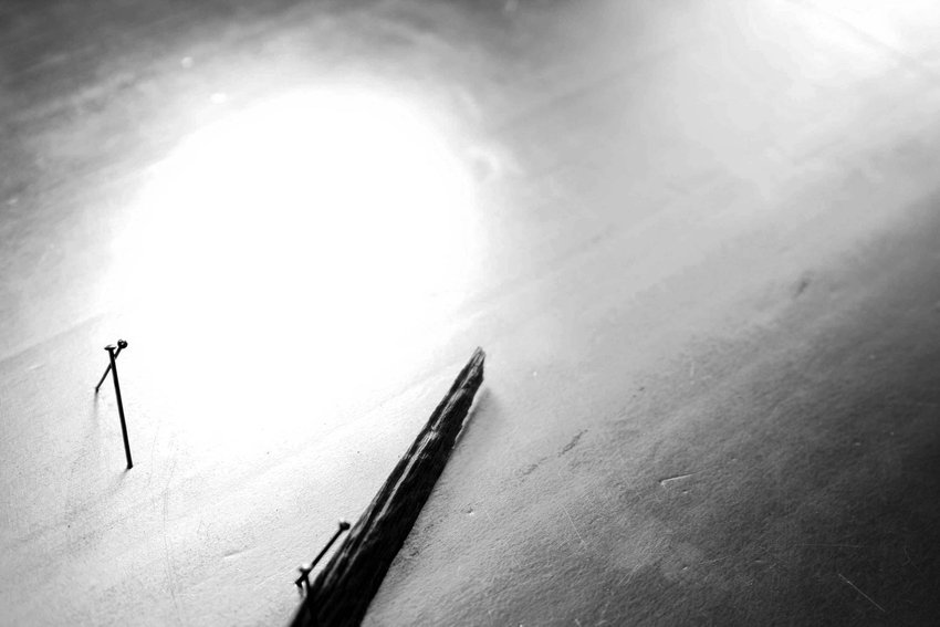 A black and white photograph of a pen on a table seen from above, Soundtracks
