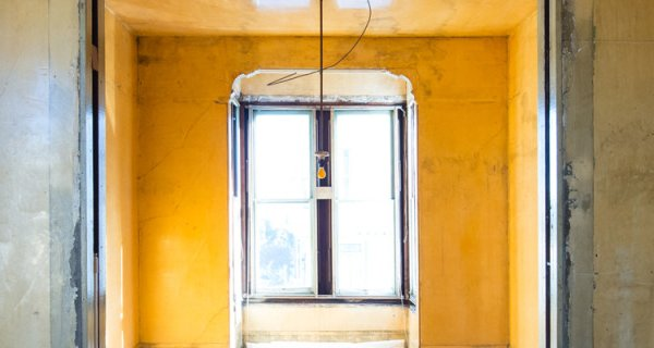 A dilapidated yellow hallway in the David Ireland house.