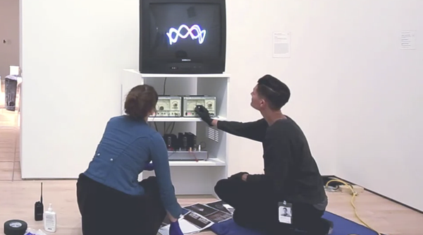 SFMOMA staff installing a Nam June Paik video work