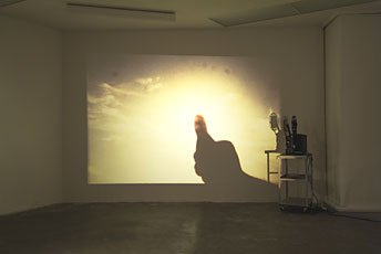 installation shot projected image of sky onto wall