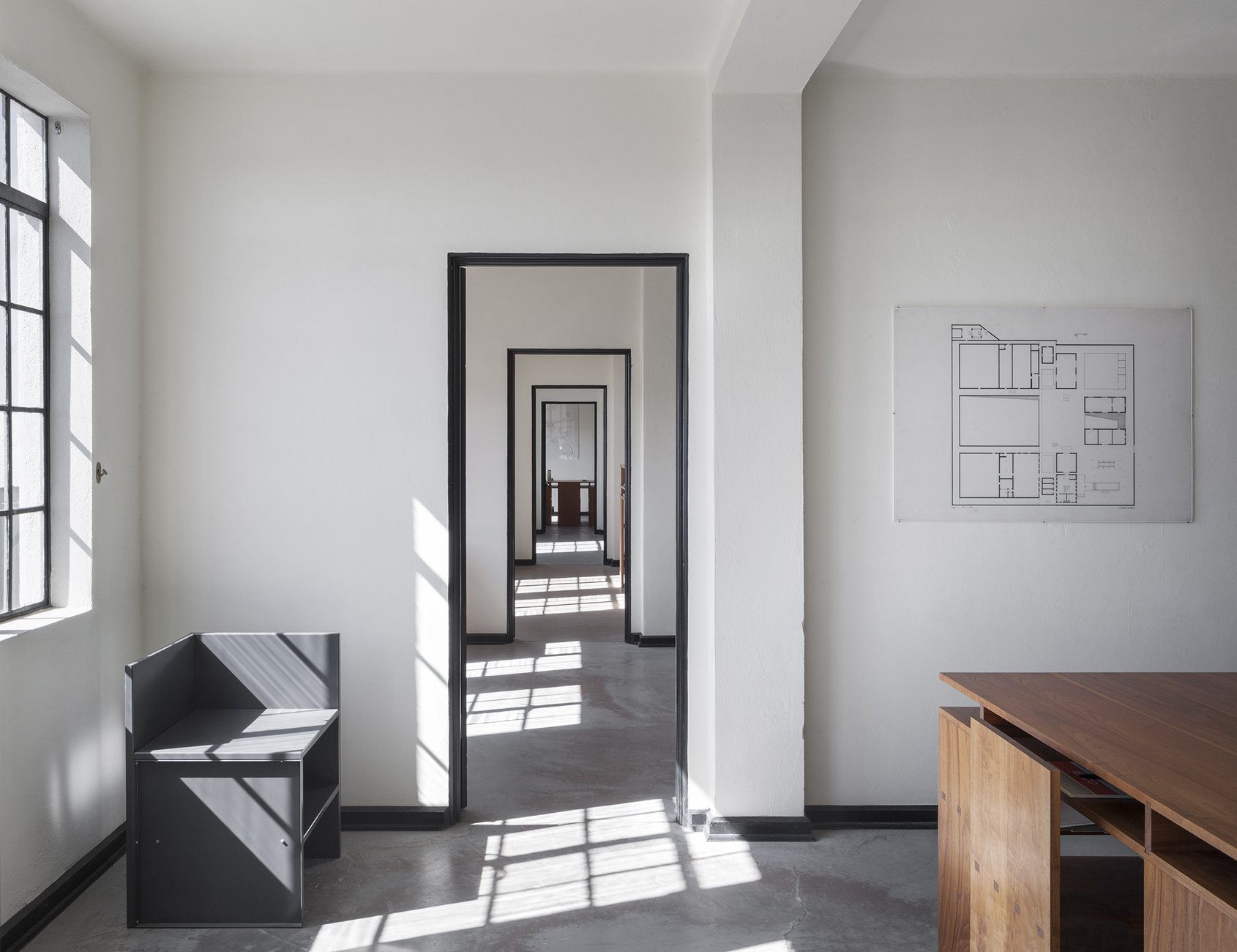 white and bright hallway with several door frames