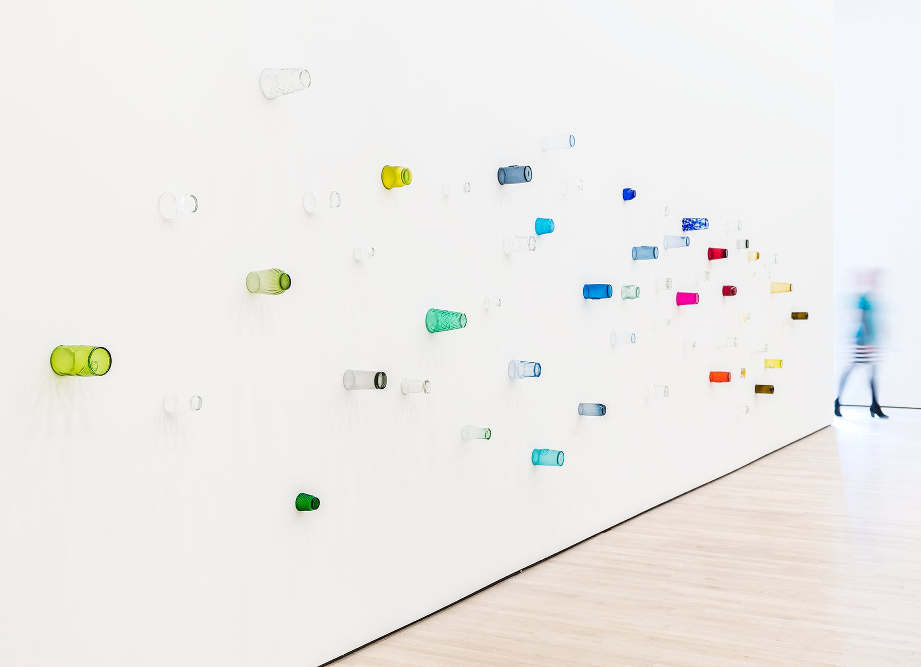 Colored drinking glasses mounted on a white wall, Pica, Soundtracks