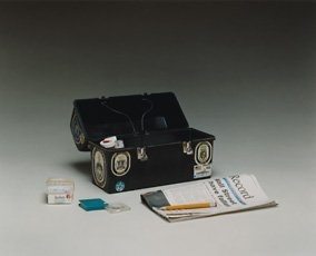 Gary Gilpatrick, box with newspaper and pencil
