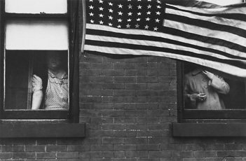 Robert Frank, photo of two people in windows with american flag