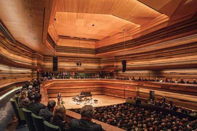A wood-paneled auditorium