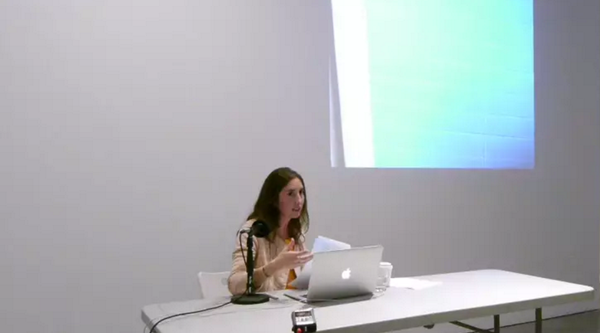 Video still of art historian Suzanne Howard speaking on Agnes Martin