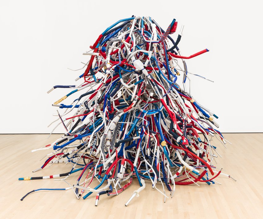 A tangled mess of red, white, and blue tubes