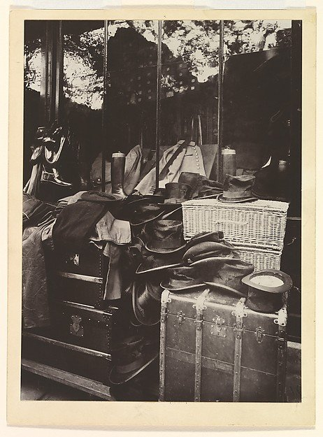 A black and white photograph of a storefront window display, Eugene Atget