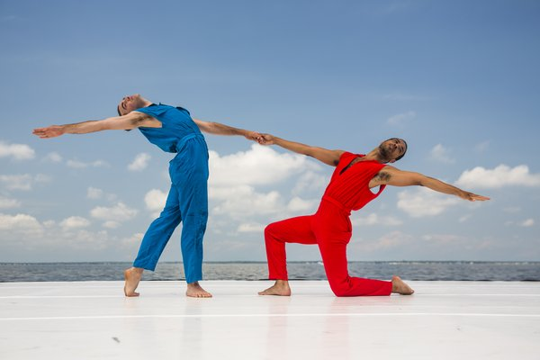 Two dancers onstage, part of Rashaun Mitchell and Silas Riener's DESIRE LINES: RETROFIT