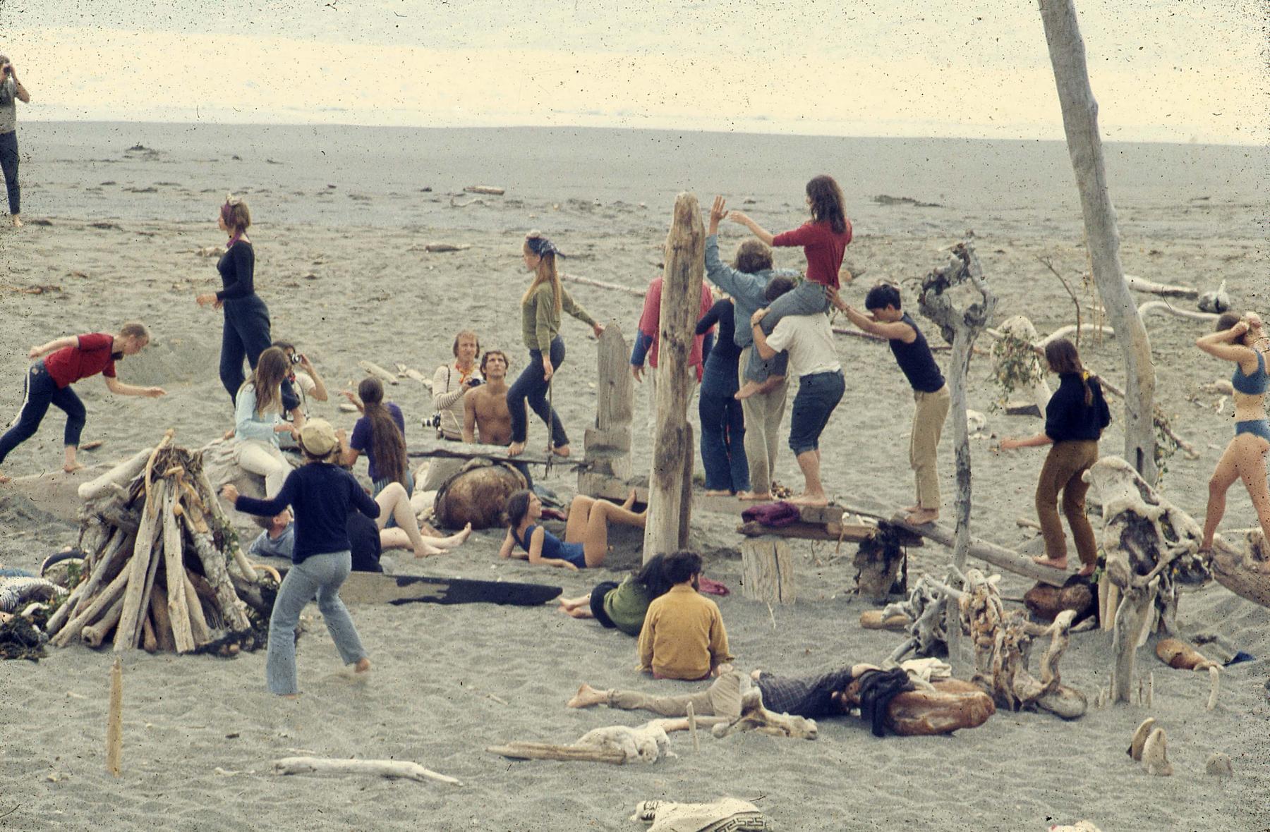 Sea Ranch people at a beach walking balancing on wood bark