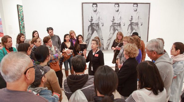 A guided tour in front of Andy Warhol's Triple Elvis