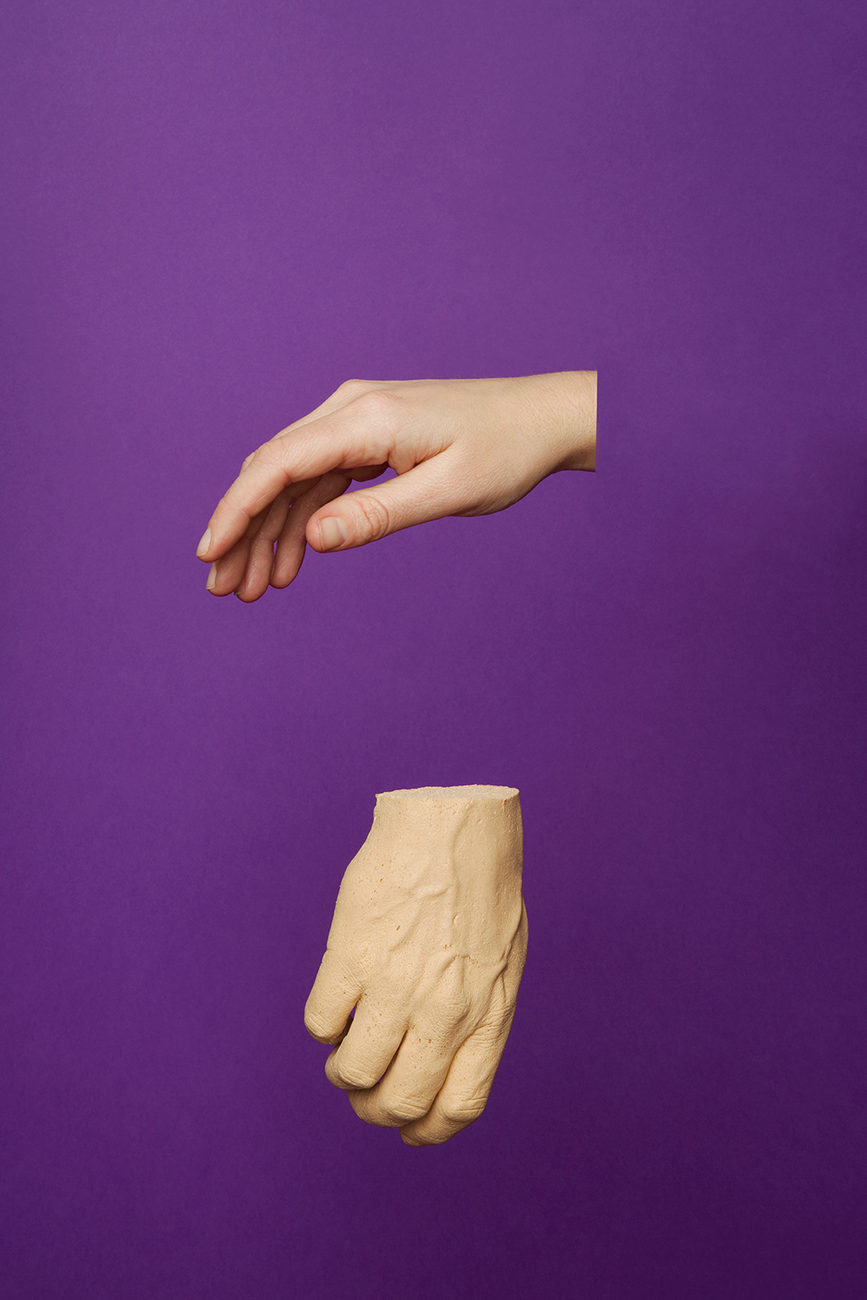 Two disembodied hands suspended against a purple background