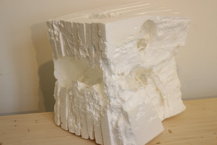 A rectangular amorphous sculpture in white, Soundtracks