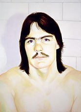 portrait of shirtless man with mustache and long hair in bathroom