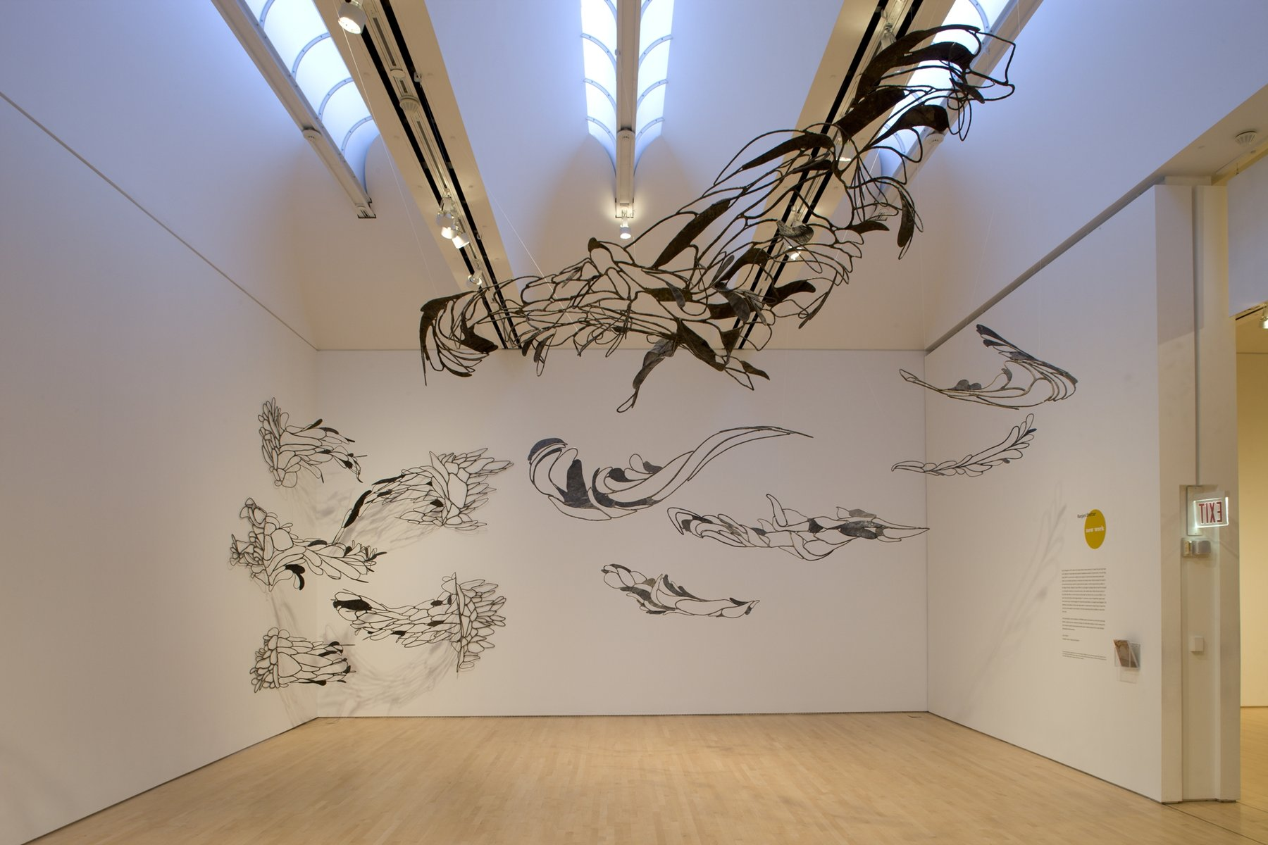 A room filled with hanging metallic sculptures