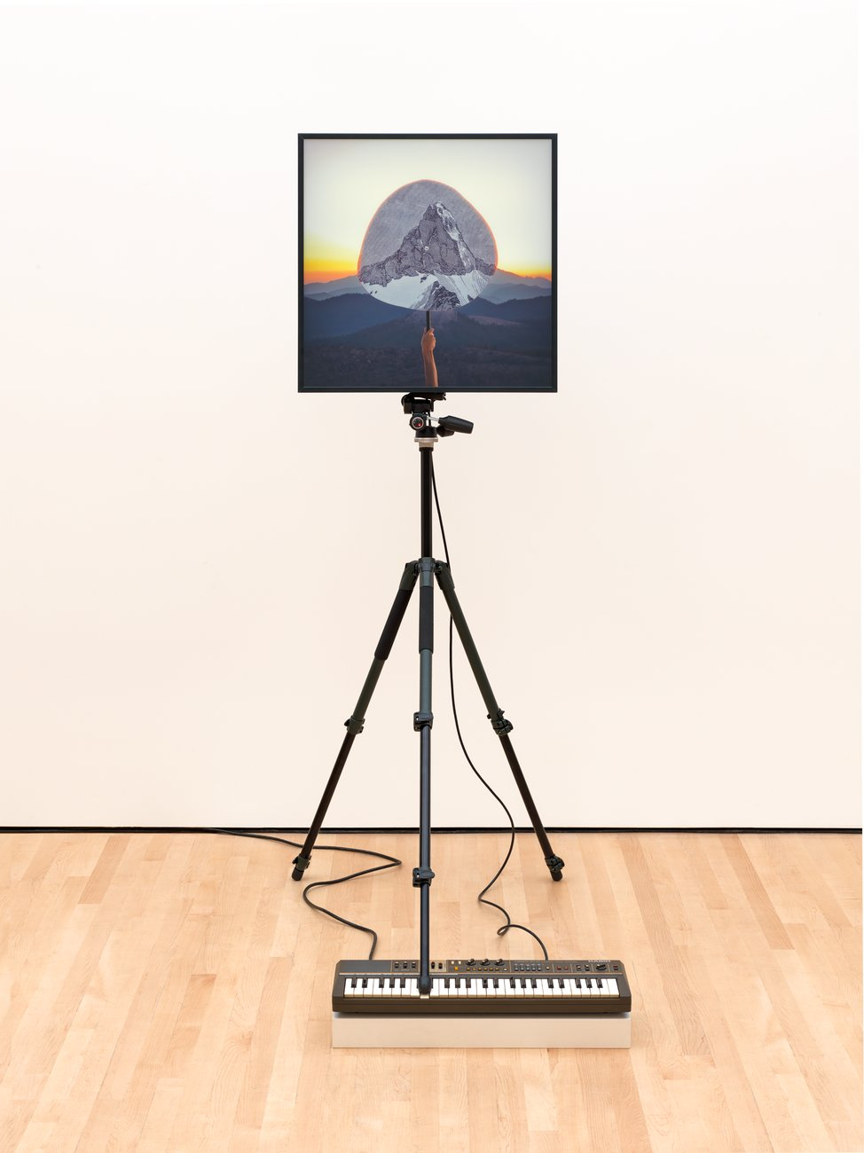 An image of a mountain mounted on a tripod standing on top of an electric keyboard, Walker Soundtracks