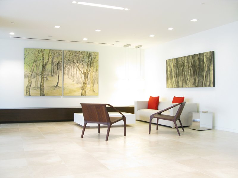 Financial office reception area with paintings hanging on the walls.