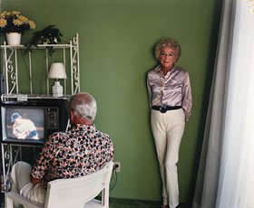 Larry Sultan, photograph of mother standing up and father watching tv