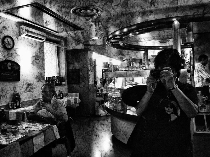 Black and white photograph of a person taking a photograph reflected in a mirror, Moriyama