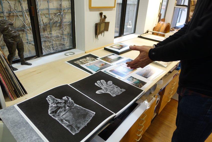 Henrik Kam shows his black and white photographs of gloves