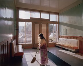 Janet Delaney, photo of woman sweeping hotel lobby