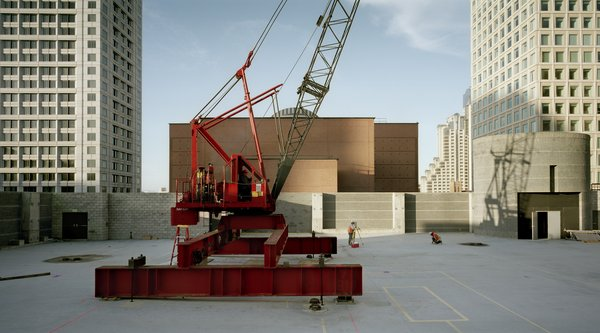 Red crane on SFMOMA rooftop garden construction site