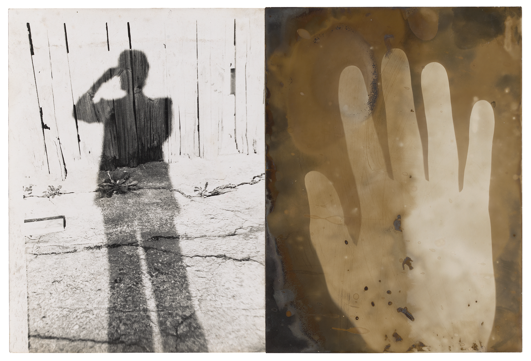 a shadow of a man and a hand