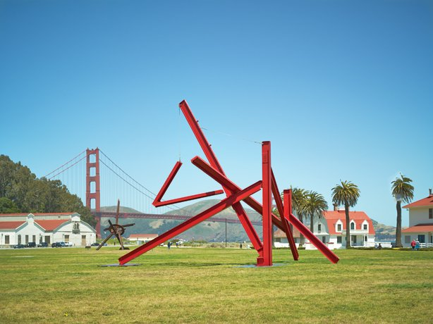 Mark di Suvero, red metal sculpture on field in front of golden gate bridge
