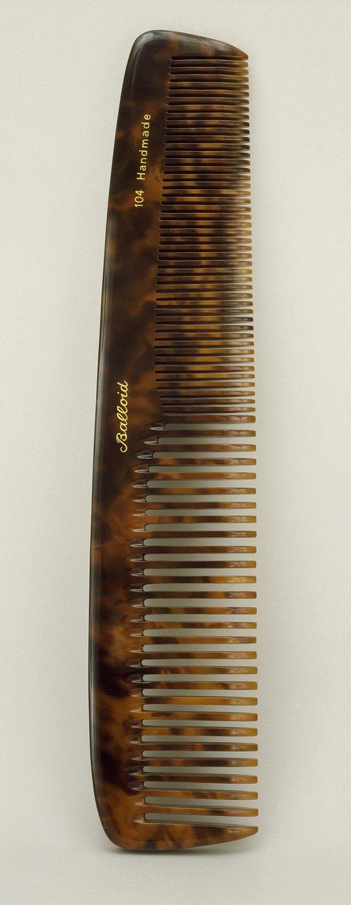 wooden sculpture of a comb, Vija Celmins
