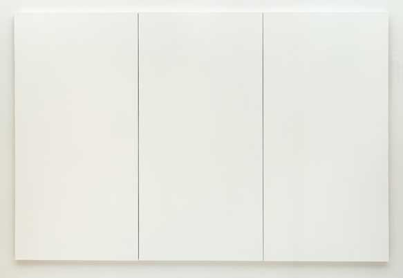 Three vertical white canvases are arranged in a row