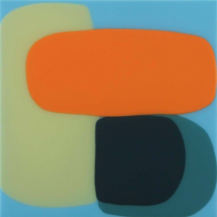Orange, black and light green blobs against a turquoise background