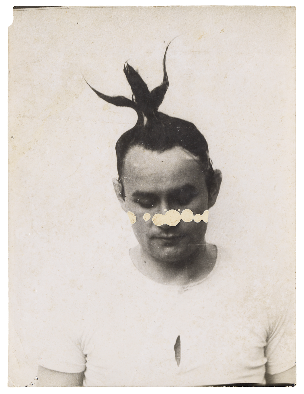 Johanne Brus, photo of young man with spiked hair and paint drips on his face