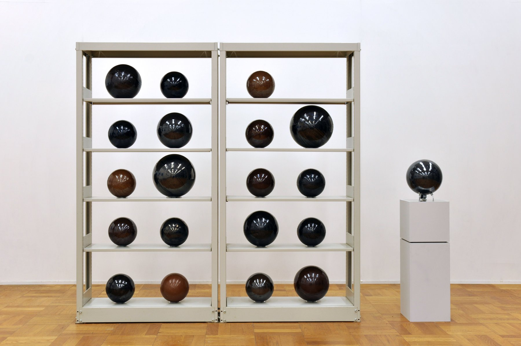Several spheres on a shelf create a grid, Yagi Soundtracks